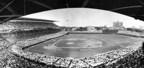 Ron Santo hit into a double play in this panoramic view of Wrigley Field in a 1968 game against the St. Louis Cardinals.