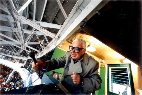 """Cubs broadcaster Harry Caray lead a 7th-inning singing of """"Take Me Out to the Ballgame"""" on Opening Day in 1988."""