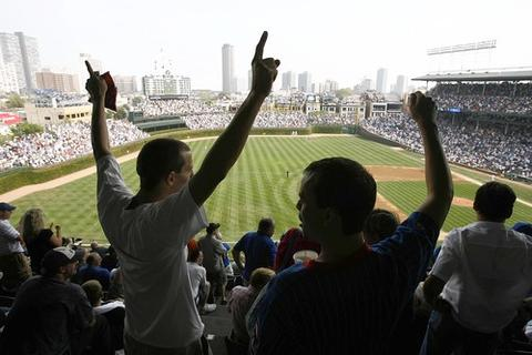 Cub fans react to Alfonso Soriano's home run in the bottom of the first inning during the roller coaster game with the Pittsburgh Pirates at Wrigley Field in September 2007. The Cubs won the game 13-7.
