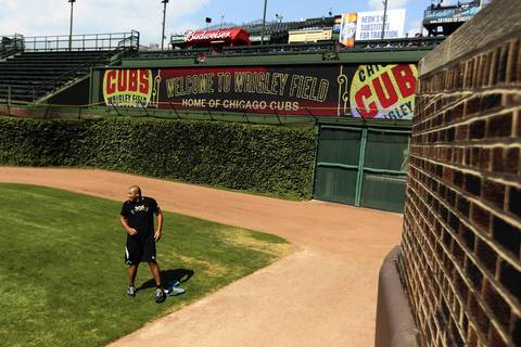 Carlos Zambrano does conditioning work in the Wrigley Field outfield.