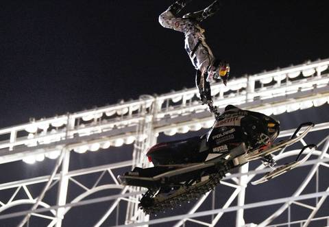 Daniel Bodin brings home a victory in his last jump at the Red Bull Fuel + Fury, a freestyle snowmobile event in front of Wrigley Field.