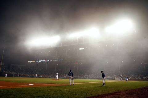 Carlos Marmol works the mound as the fog moves in during the eighth inning.
