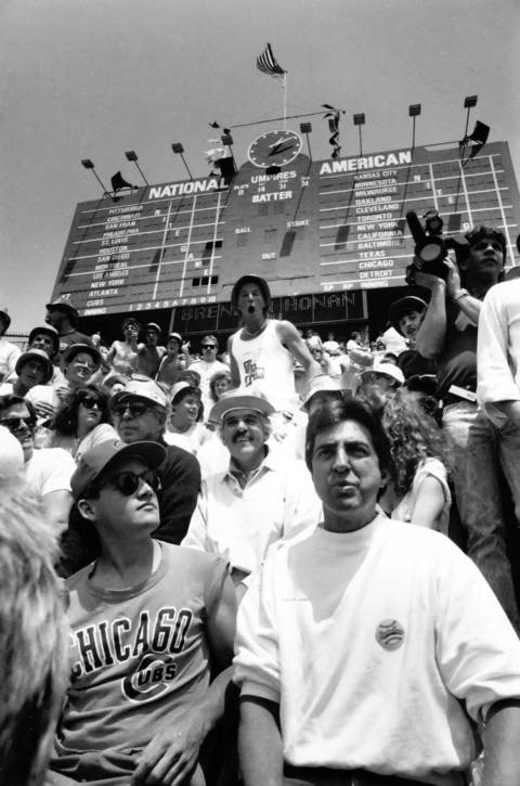 Joe Mantegna (foreground) and Dennis Farina (behind) join other members of the cast of ¿The Bleacher Bums¿ in right field bleachers at Wrigley Field on May 16, 1989.