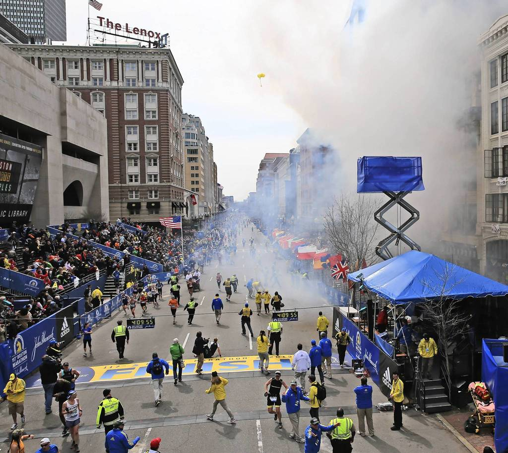 Exlosions go off near the finish line of the 117th Boston Marathon.