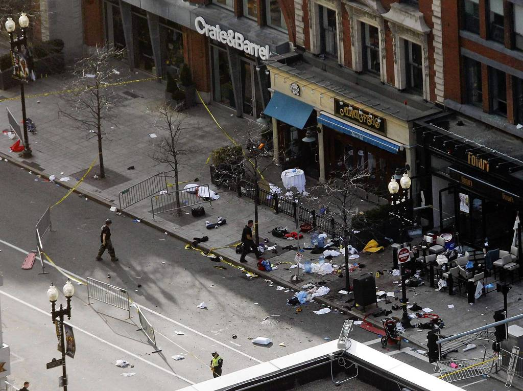Debris is seen along Boylston Street after explosions went off at the 117th Boston Marathon.