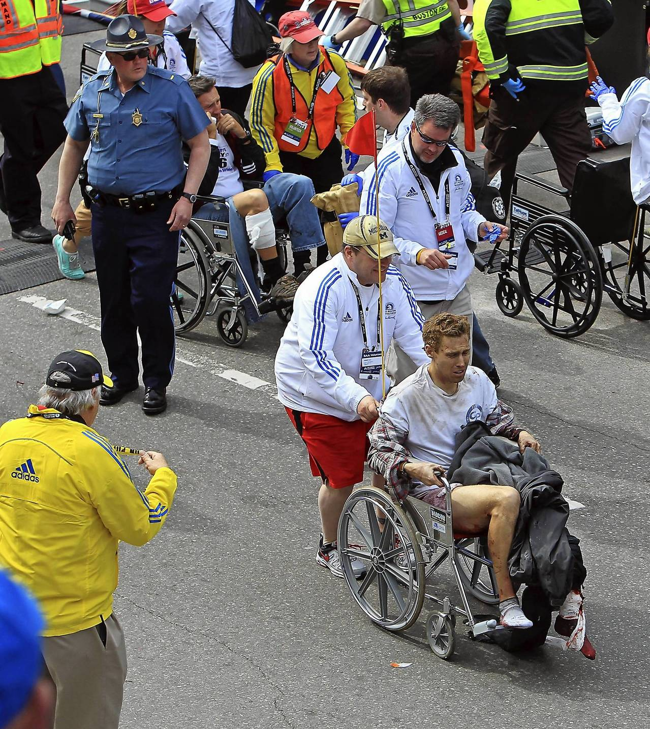 Victims of the bomb blast during the Boston Marathon are assisted in Boston, Massachusetts.