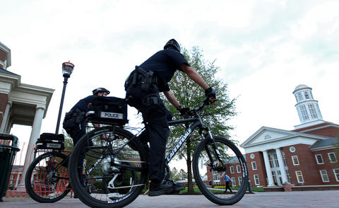 Newport News police officers patrol the Christopher Newport University Tuesday evening after several fires were set in bathrooms around campus.