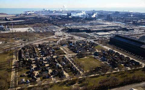 The Marktown neighborhood of East Chicago, Ind. is seen from the air. BP, which owns an adjacent petroleum refinery, wants to use the land where Marktown's 219 homes now sit for a parking lot. Though a formal offer is not yet on the table, BP has announced it is shopping for a real estate agent to determine the fair-market property values of Marktown houses.