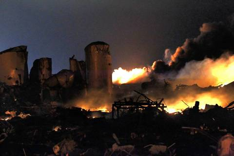 The remains of a fertilizer plant burn after an explosion at the plant in the town of West, near Waco, Texas. The deadly explosion ripped through the fertilizer plant late on Wednesday, injuring more than 100 people, leveling dozens of homes and damaging other buildings including a school and nursing home, authorities said.