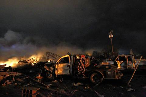 The remains of a fertilizer plant burn after an explosion at the plant in the town of West, near Waco, Texas.