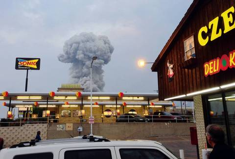 People at the Czech Stop look at a cloud of smoke rising from an explosion at a fertilizer plant in West, Texas.