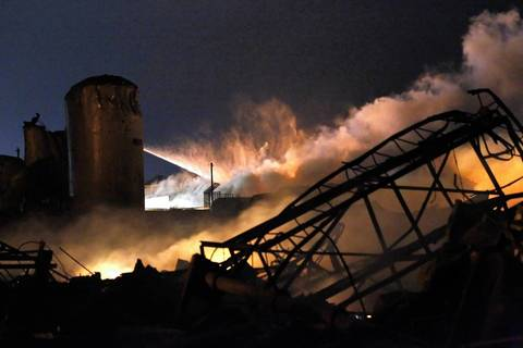 Smoke rises as water is sprayed at the burning remains of a fertilizer plant after an explosion at the plant in the town of West, near Waco, Texas.
