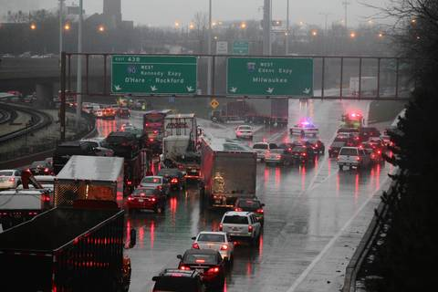 Traffic is stopped at the junction of the Edens and Kennedy expressways due to flooded roads.