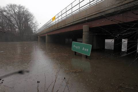 Looking north, the Edens Expressway is under water at Pratt Ave. in Lincolnwood, Ill. People had been rescued from a car that is now completely submerged.