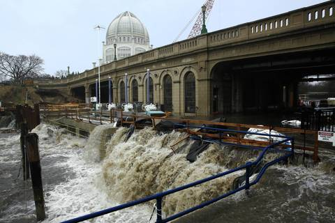 Flooding causes a breach of the locks under Sheridan Road in Wilmette, overwhelming construction at the rehabilitation of the diversion pumps at the Wilmette Pump Station.