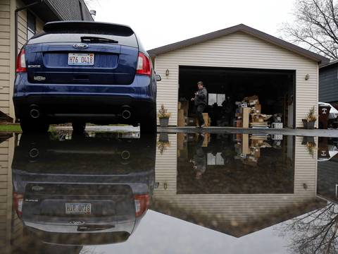 Frank Cirrione of the Oak Terrace subdivision in Mundelein, relocates boxes from his basement to his garage.