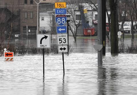 Streets are completely flooded at Lincoln Avenue and Route 53 in Lisle after a morning of heavy rain.