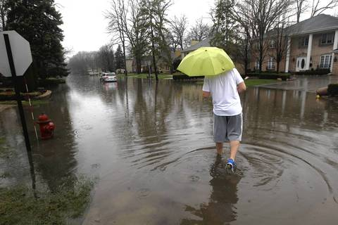 Aid Idrizovic of Lincolnwood looks at the car stranded in the middle of Longwood Avenue at Pratt Avenue.