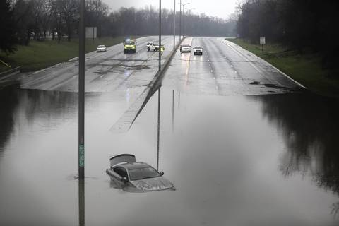 A car is revealed as water on the Edens Expressway recedes. The water was high enough that the vehicle was completely submerged.