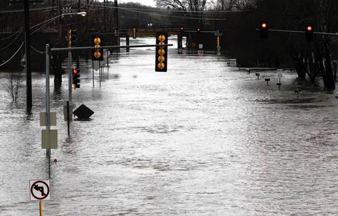 Route 53 in Lisle, just south of Ogden Avenue, remains closed to traffic and pedestrians, as flood waters gain the upper hand.