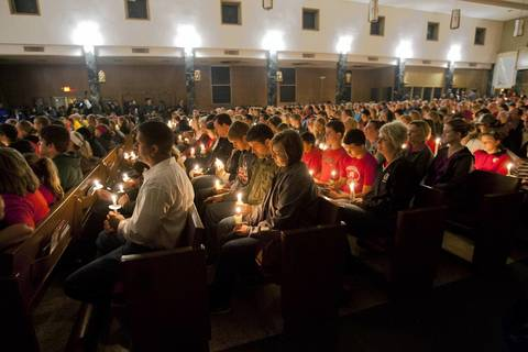 West community residents take part in a candlelight vigil at St. Mary's Assumption Catholic Church in West, Texas in remembrance of those who lost their lives or were injured in the massive explosion at a fertilizer plant in West, Texas.
