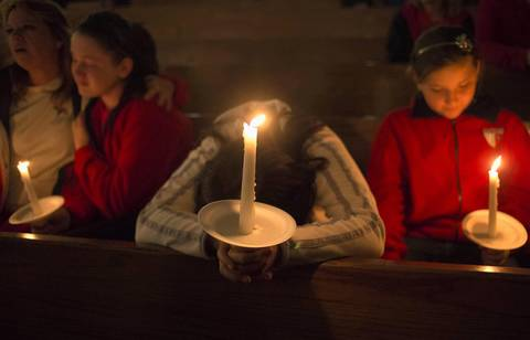A woman mourns during a candlelight service at St. Mary's Assumption Catholic Church in West, Texas for victims of a fertilizer plant explosion in the town of Wes, Texas.