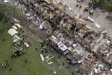 Search and rescue workers comb through what remains of a 50-unit apartment building the day after an explosion at the West Fertilizer Company destroyed the building in West, Texas. According to West Mayor Tommy Muska, around 12 people, including 10 first responders, were killed and more than 150 people were injured when the fertilizer company caught fire and exploded, leaving damaged buildings for blocks in every direction.