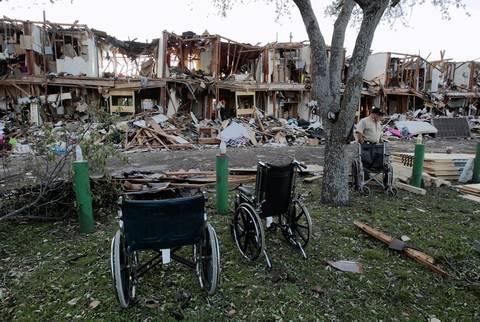 Firefighters searched the remains of an apartment complex next to the fertilizer plant that exploded in West, Texas. According to West Mayor Tommy Muska, around 12 people, including 10 first responders, were killed and more than 150 people were injured when the fertilizer company caught fire and exploded, leaving damaged buildings for blocks in every direction.