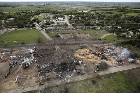 The West Fertilizer Company, shown from the air, lies in ruins in West, Texas. According to West Mayor Tommy Muska, around 12 people, including 10 first responders, were killed and more than 150 people were injured when the fertilizer company caught fire and exploded on Wednesday, leaving damaged buildings for blocks in every direction.