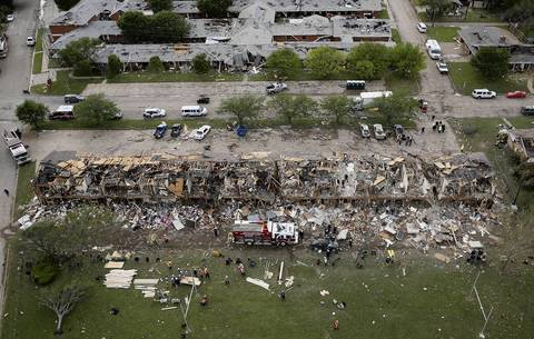 Search and rescue workers comb through what remains of a 50-unit apartment building, bottom, and the West Rest Haven Nursing Home, top, the day after an explosion at the West Fertilizer Company destroyed the buildings in West, Texas.
