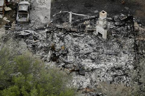 A home burned to the ground by an explosion yesterday at the West Fertilizer Company is shown from the air in West, Texas. Only the chimney remains.