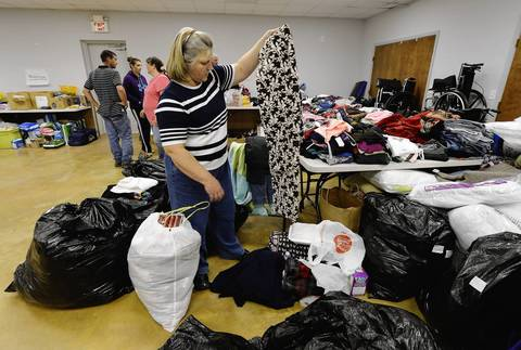 Jackie Arias, center, picks up donated clothing at VFW Post 4819 after her house was damaged from the West Fertilizer Company explosion.