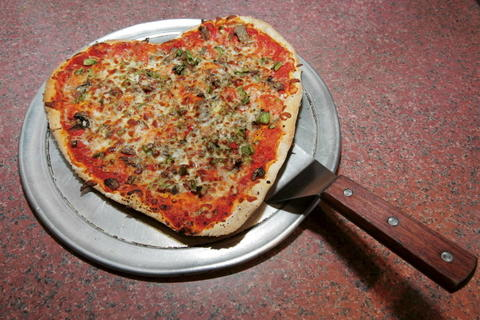A heart-shaped thin-crust pizza with the works at My Pie, 2010 N. Damen Ave.
