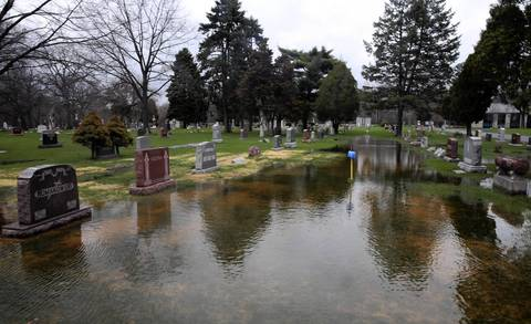 A lake of water floods All Saints Catholic Cemetery & Mausoleum at 700 N. River Road in Des Plaines.