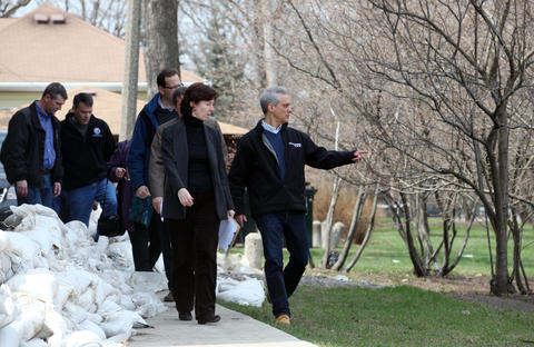 Chicago Ald. Margaret Laurino (39th) talks with Mayor Rahm Emanuel as they walk past sandbags in the Albany Park neighborhood on Sunday. Emanuel announced that the City of Chicago will join the Metropolitan Water Reclamation District to move forward on an extensive tunnel project in order to reduce the potential for flooding on Chicago's Northwest Side.