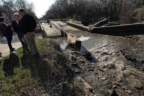 Morris Mayor Richard P. Kopczick visits damage caused to an aqueduct on the I&M Canal by flooding near the Illinois River.