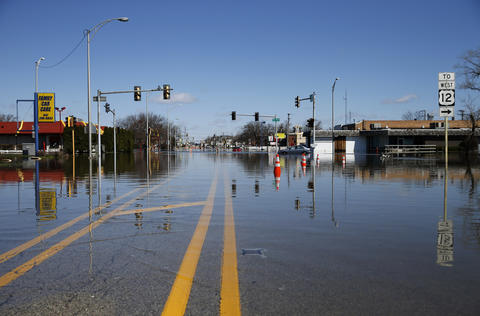 River Road in Des Plaines remains flooded on Saturday.