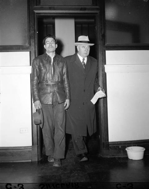Perez Herlindo Arias, left, leaves the States Attorney's office on Dec. 21, 1948 with Captain Daniel Gilbert, right, to take a lie detector test. Arias was one of the many suspects questioned in the murder of Roberta Rinearson.