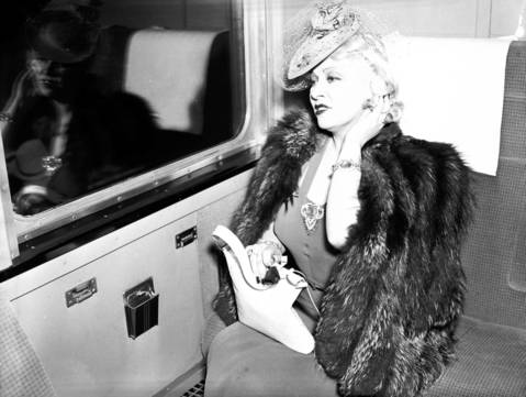 """When I'm good I'm very good. But when I'm bad, I'm better."" Actress Mae West leaves from Dearborn Street Station on a train for Hollywood, May 29, 1939. West was an independent woman who became a movie icon. The first play she wrote, in the 1920s, was titled ""Sex."""