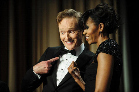Comedian Conan O'Brien and first lady Michelle Obama pose for the cameras during the White House Correspondents' Association Dinner on April 27, 2013 in Washington, DC. The dinner is an annual event attended by journalists, politicians and celebrities. (Photo by Pete Marovich-Pool/Getty Images)