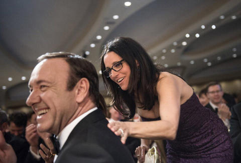 Actress Julia Louis-Dreyfus pats actor Kevin Spacey on the back during the White House Correspondents? Association Dinner April 27, 2013 in Washington, DC. Obama attended the yearly dinner which is attended by journalists, celebrities and politicians. AFP PHOTO/Brendan SMIALOWSKI (Photo credit should read BRENDAN SMIALOWSKI/AFP/Getty Images)