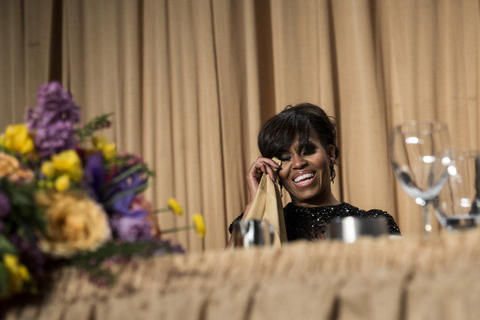 First lady Michelle Obama laughs during the White House Correspondents' Association Dinner April 27, 2013 in Washington, DC. Obama attended the yearly dinner which is attended by journalists, celebrities and politicians. AFP PHOTO/Brendan SMIALOWSKI (Photo credit should read BRENDAN SMIALOWSKI/AFP/Getty Images)