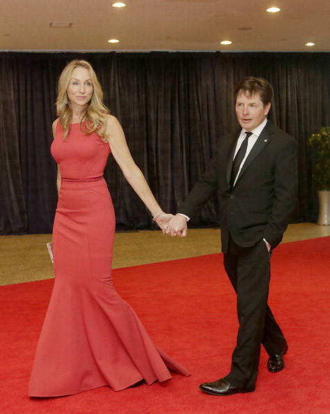 Actress Tracey Pollan and her husband, actor Michael J. Fox arrive at the annual White House Correspondents' Association dinner in Washington DC, April 27, 2013. AFP Photo/ Chris KLEPONIS (Photo credit should read CHRIS KLEPONIS/AFP/Getty Images)