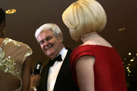 Former Speaker of The House of Representative Newt Gingrich and his wife Calista Gingrich speak to the media upon arriving at the annual White House Correspondents' Association dinner in Washington DC, April 27, 2013. AFP Photo/ Chris KLEPONIS (Photo credit should read CHRIS KLEPONIS/AFP/Getty Images)