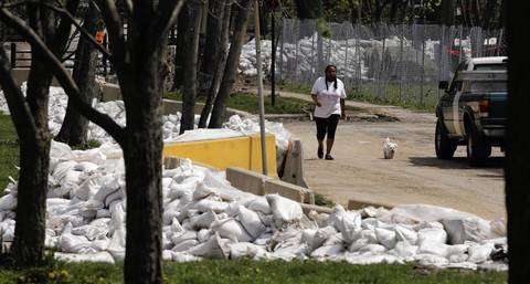 Sand bags still line Carmen Avenue near Lawndale Avenue, just south of the North Branch of the Chicago River. Local, state and federal officials were in the Albany Park neighborhood today assessing flood damage of homeowners and apartment dwellers.
