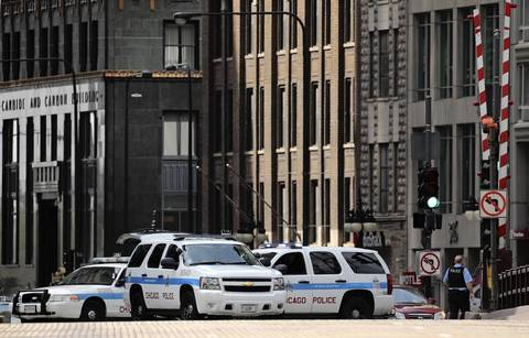 Squad cars and SUVs block off the Du Sable (Michigan Avenue) bridge after a suspicious package tied to a flagpole was found on the 400 block of North Michigan Avenue.