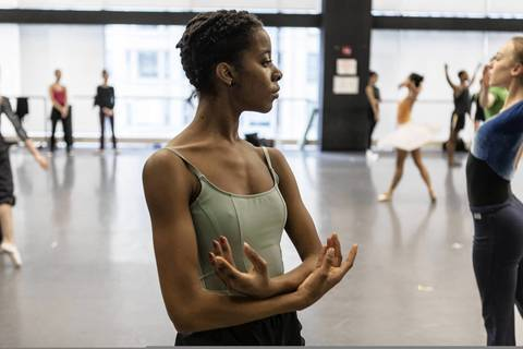 Dara Holmes rehearses with the company in their space at 10 E. Randolph St.