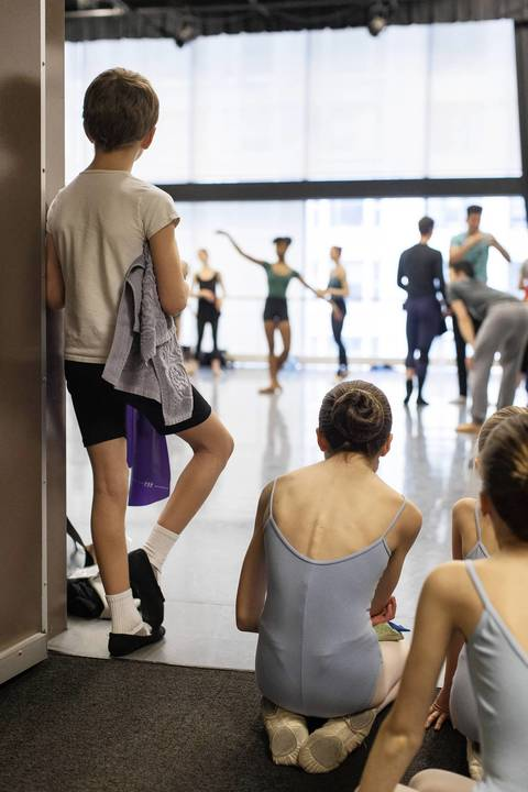 Members of the Children's Division of the Joffrey Academy of Dance watch Joffrey company dancers rehearse.