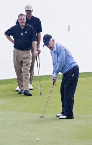 Frank Beamer, head football coach at Virginia Tech University, putts on the 17th hole at the 2013 Kingsmill Championship Pro-Am on Wednesday.