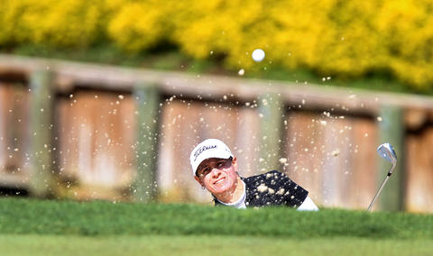 Heather Bowie Young hits out of the bunker on the 18th hole during first round of the Kingsmill Championship Thursday in Wiliamsburg.